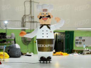 Пекарь зазывала с машущей рукой